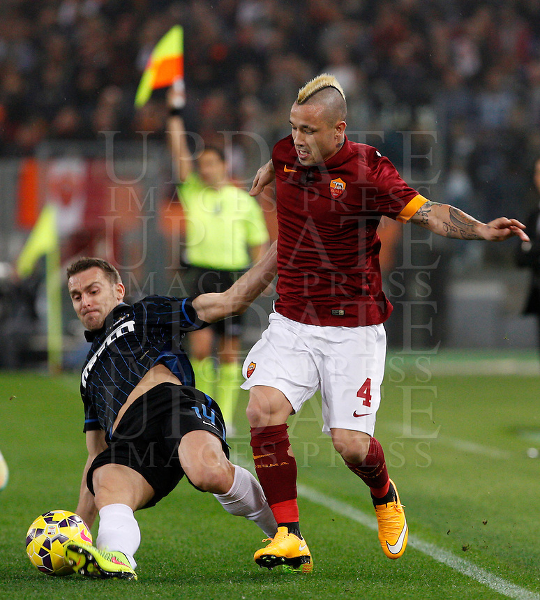 Calcio, Serie A: Roma vs Inter. Roma, stadio Olimpico, 30 novembre 2014.<br /> Roma&rsquo;s Radja Nainggolan is tackled by FC Inter&rsquo;s Hugo Armando Campagnaro, left, during the Italian Serie A football match between AS Roma and FC Inter at Rome's Olympic stadium, 30 November 2014.<br /> UPDATE IMAGES PRESS/Riccardo De Luca