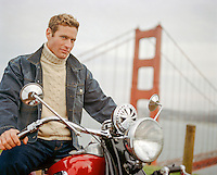 Paul Newman look-a-like on a motorcycle by The Golden Gate Bridge in San Francisco