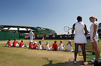 Wimbledon Junior Tennis Initiative - Demonstration on Court 14, AELTC...Tennis - Grand Slam - Wimbledon - AELTC - London- Day 13-  Sun July 3rd 2011..© AMN Images, Barry House, 20-22 Worple Road, London, SW19 4DH, UK..+44 208 947 0100.www.amnimages.photoshelter.com.www.advantagemedianetwork.com.
