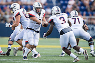 Annapolis, MD - SEPT 10, 2016: Connecticut Huskies quarterback Bryant Shirreffs (4) hands the ball off to Connecticut Huskies running back Ron Johnson (3) during their match up against Navy at Navy-Marine Corps Memorial Stadium in Annapolis, MD. Navy held on to defeat Connecticut 28-24. (Photo by Phil Peters/Media Images International)