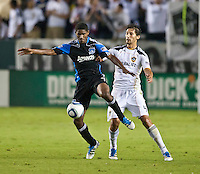 CARSON, CA – August 20, 2011: San Jose Earthquake midfielder Khari Stephenson (7) and LA Galaxy defender Omar Gonzalez (4) during the match between LA Galaxy and San Jose Earthquakes at the Home Depot Center in Carson, California. Final score LA Galaxy 2, San Jose Earthquakes 0.