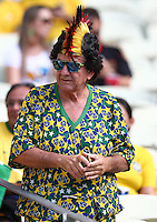 A supporter wearing a Germany wig and a Brazilian themed football shirt inside the Estadio Castelao ahead of kick off