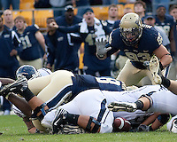 Pittsburgh defense causes a fumble that is eyed by Gus Mustakas (93). Pittsburgh Panthers defeat the University of Connecticut Huskies 24-21 on October 10, 2009 at Heinz Field, Pittsburgh, PA.
