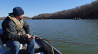 NWA Democrat-Gazette/FLIP PUTTHOFF<br /> Jon Stein, fisheries biologist with the Arkansas Game and Fish Commission, trolls while watching anglers in several boats congregated Dec. 4, 2015 in Monte Ne cove at Beaver Lake.