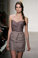 Model walks runway in a mauve pencil skirt dress, draped mikado organza bodice, strapless sweetheart neckline, lace skirt, tie with crystal accents and natural waist bridesmaid dress by Lazaro Perez, from the Noir by Lazaro Spring 2012 Bridal fashion show.