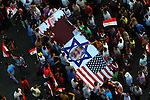A general view of Egyptians opposing President Morsi taking part in a protest demanding him to leave office, in front of the presidential palace in Cairo, Egypt, 30 June 2013. Tens of thousands of Egyptians took to the streets in rival rallies on 30 June, as the opposition demanded Islamist President Mohammed Morsi step down on his first anniversary in office. Tensions between Morsi's supporters and his opponents have risen in the lead-up to the anniversary, with at least seven killed in clashes last week. Photo by Ahmed Asad