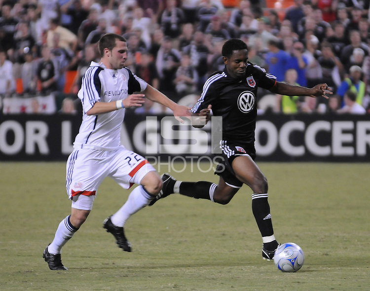 DC United forward Emilio (11) carries the ball ahead of New England Revolution defender Rob Valentino (22). DC United defeated The New England Revolution 3-1, on the Semifinal game of the Lamar Hunt U.S. Open Cup, Tuesday August 12, 2008 at RFK Stadium.