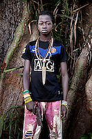 An Anti-Balaka (Anti-Machete) fighter wearing a Manchester United football shirt and holding a battered and rusting handgun. In late 2012 after years of instability and conflict, the Seleka, a predominantly Muslim rebel group, fuelled by grievances against the government, overran the country and, In March 2013, ousted President Francois Bozize, who fled the country. The rebel's leader Michel Djotodia was proclaimed president in August 2013. He disbanded the Seleka in September 2013 but law and order collapsed and ex-Seleka fighters roamed the country committing atrocities against the civilian population. In an attempt to defend their lives and property vigilante groups, calling themselves Anti-Balaka (Anti-Machete), formed to confront the ex-Seleka fighters but soon began to take reprisals against the wider Muslim population and the conflict became increasingly sectarian. By December 2013, with international fears of a genocide being voiced, French led peacekeepers deployed to the country began to act on a UN mandate to disarm the fighters and protect the civilian population. However, they have struggled to contain the situation. Much of the Muslim population, in particular, have been forced into ghettos where they are suffering from food shortages and limited access to healthcare. Often, only a few peacekeepers stand between them and a massacre by vengeful Anti-Balaka militants. UN reports describe 'thousands' killed, while over 600,000 people have been internally displaced and a further 200,000 have fled the county.