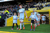 GJ van Velze of Worcester Warriors, mascots in hand, leads his team out onto the field. Aviva Premiership match, between Saracens and Worcester Warriors on November 28, 2015 at Twickenham Stadium in London, England. Photo by: Patrick Khachfe / JMP