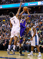Kobe Bryant of the Lakers shoots over Nick Young of the Wizards. Los Angeles defeated Washington 103-89 at the Verizon Center in Washington, DC on Tuesday, December 14, 2010. Alan P. Santos/DC Sports Box