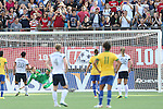 10 November 2013: Abby Wambach (USA) (20) scores a penalty kick goal past Luciana (BRA) (12). The United States Women's National Team played the Brazil Women's National Team at the Citrus Bowl in Orlando, Florida in an international friendly soccer match. The U.S. won the match 4-1.