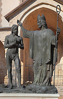 Statue of the baptism of Clovis by St Remi in Reims in 496 AD, by Daphne du Barry, commissioned by Champagne Louis Roederer on the 15th centenary of the event in 1996, outside the South Portal of the Basilique Saint Remi or Abbey of St Remi, Reims, France. The 11th century, mainly Romanesque, church, contains the relics of St Remi, the Bishop of Reims, who converted Clovis, the King of the Franks, to Christianity. The abbey is a UNESCO World Heritage Site. Picture by Manuel Cohen