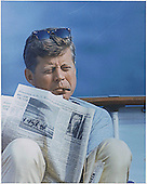 United States President John F. Kennedy with cigar and New York Times aboard the &quot;Honey Fitz&quot; off Hyannisport, Massachusetts on August 31, 1963.<br /> Mandatory Credit: Cecil Stoughton/White House via CNP