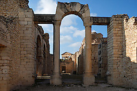 Low angle view of arch in the Frigidarium in the Baths of Licinius, 3rd century, in Dougga, Tunisia, pictured on January 31, 2008, in the afternoon. Dougga has been occupied since the 2nd Millennium BC, well before the Phoenicians arrived in Tunisia. It was ruled by Carthage from the 4th century BC, then by Numidians, who called it Thugga and finally taken over by the Romans in the 2nd century. Situated in the north of Tunisia, the site became a UNESCO World Heritage Site in 1997. The Baths of Licinius or the Winter Baths were constructed in 260 A.D. The bathing complex had marble walls and mosaic floor. It featured all the comforts of a classical Roman bath: a Frigidarium (cold room) in the center, Tepidarium (water bath), Caldarium (hot bath), lavatory and a Sudatorium (sweat bath). Picture by Manuel Cohen.