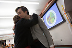 Jan Pepper receives a hug from her son at the Dec. 4 swearing-in ceremony for new councilmembers.