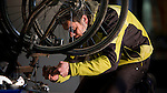 Kim Ngyuen from Ride Planet Earth and the Zero Carbon Collective works on a bike in preparation for the long ride to Amsterdam.