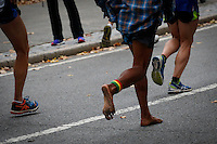 A men runs without shoes during the annual TCS New York City Marathon in Central Park New York 01.11.2015. Mary Keitany wins second consecutive NYC Marathon, Stanley Biwott is men's winner. Ken Betancur/VIEWpress.