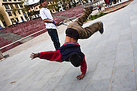 Youths hang around the city's main clock tower area in downtown Thimphu, playing sports and dancing.
