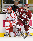 Charlie Coyle (BU - 3), Mike Hogan, Pier-Olivier Michaud (Harvard - 39) - The Harvard University Crimson defeated the Boston University Terriers 5-4 in the 2011 Beanpot consolation game on Monday, February 14, 2011, at TD Garden in Boston, Massachusetts.