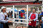 Republican presidential hopeful Tim Pawlenty, right, flips a pork chop into the air at the Iowa Pork Producers booth at the Iowa State Fair on Friday, August 12, 2011 in Des Moines, IA.