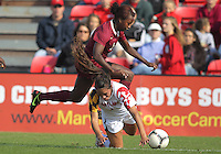 COLLEGE PARK, MD - OCTOBER 21, 2012:  Erika Nelson (15) of the University of Maryland falls after a tackle by Jessica Price (6) of Florida State during an ACC women's match at Ludwig Field in College Park, MD. on October 21. Florida won 1-0.