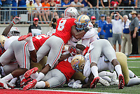 Ohio State Buckeyes cornerback Gareon Conley (8) helps stop Tulsa Golden Hurricane running back James Flanders (20) on fourth down at the goal line during the first quarter of the NCAA football game between the Ohio State Buckeyes and the Tulsa Golden Hurricane at Ohio Stadium on Saturday, September 10, 2016. (Columbus Dispatch photo by Jonathan Quilter)