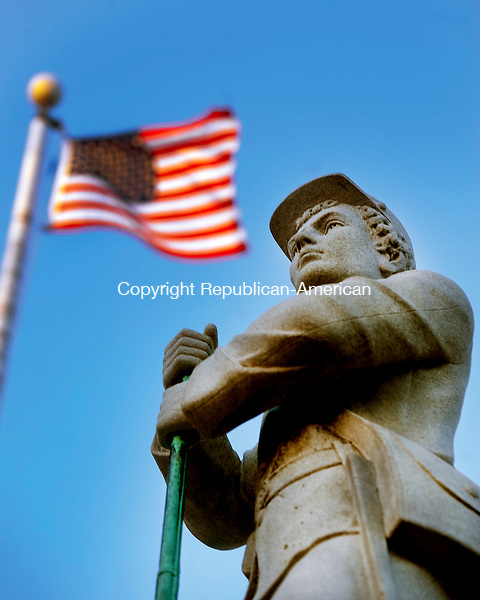 PROSPECT,  CT,  CT-041115JS02-  The American Flag flies behind the soldier atop the   Soldiers' Monument  on the Prospect Green. <br /> Jim Shannon Republican-American