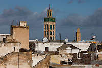 Rooftop view, Meknes, Morocco pictured on December 26, 2009. A minaret soars over house roofs, many of them with satellite dishes. Meknes, one of Morocco's Imperial cities, was redeveloped under Sultan Ismail Moulay (1634-1727). It is a fortified city built from pise, or clay and straw, and was designed to be the political capital of Morocco, as opposed to Fez, the religious capital. Picture by Manuel Cohen