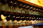 Bottles of shochu with the names of the customers who own them written on them are lined up above the counter at Enoki, a bar-cum-eatery she has run for some 25 years in Nonbeiyokjocho, or Drunkard's Alley, in trendy Shibuya district, Tokyo. Nonbeiyokocho began life immediately after World War II as a group of tea houses. Though the alley is just a short walk from the central Shibuya shopping district, the rents are low due to the area being built over a river. Today 47 eateries, each with barely enough room to swing a cat, serve beer, fine wines and good, inexpensive fare.