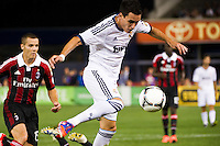 Jose Maria Callejon (21) shoots and scores. Real Madrid defeated A. C. Milan 5-1 during a 2012 Herbalife World Football Challenge match at Yankee Stadium in New York, NY, on August 8, 2012.