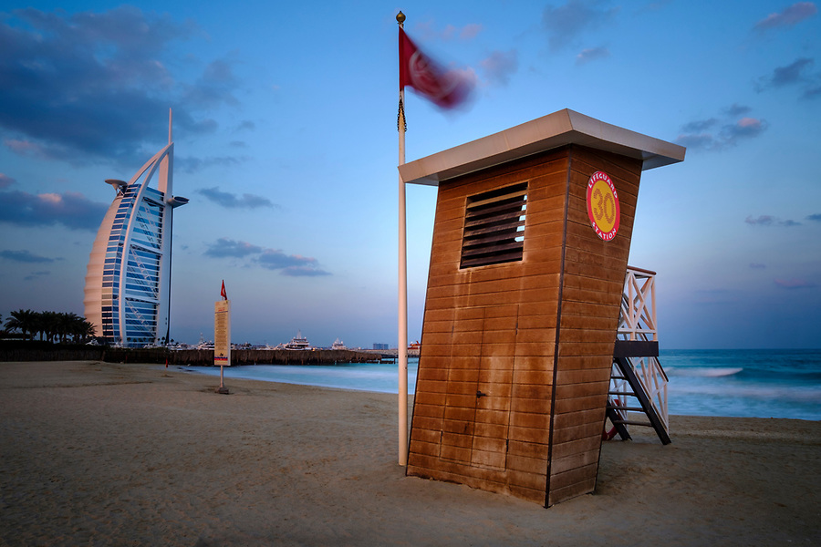 UNITED ARAB EMIRATES, DUBAI - CIRCA JANUARY 2017:  Lifeguard station at the Jumeirah Public Beach at sunrise. with view of the Burj Al Arab, the only 7 star hotel in the world.