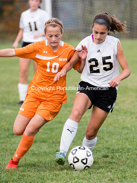 BEACON FALLS, CT- 22 October 2015-102215EC03-  Watertown's (10) Meadow Mancini and Woodland's (25) Maribella Sousa jostle for the ball Thursday. Erin Covey Republican-American