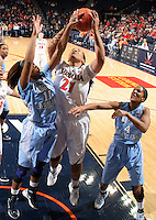 CHARLOTTESVILLE, VA- JANUARY 5: Jazmin Pitts #21 of the Virginia Cavaliers shoots between Brittany Rountree #11 and Candace Wood #4 of the North Carolina Tar Heels during the game on January 5, 2012 at the John Paul Jones arena in Charlottesville, Virginia. North Carolina defeated Virginia 78-73. (Photo by Andrew Shurtleff/Getty Images) *** Local Caption *** Candace Wood;Brittany Rountree;Jazmin Pitts