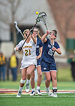 25 April 2015: University of New Hampshire Wildcat Attacker Emma Kriss, a Senior from Rockville Centre, NY, reaches for possession against University of Vermont Catamount Attacker Jessica Roach, a Senior from Scituate, MA, during game at Virtue Field in Burlington, Vermont. The Lady Catamounts defeated the Lady Wildcats 12-10 in the final game of the season, advancing to the America East playoffs. Mandatory Credit: Ed Wolfstein Photo *** RAW (NEF) Image File Available ***