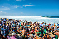 PIPELINE, Oahu/Hawaii (Saturday, December 14, 2013) - Kelly Slater (USA), 41, has won his 7th Billabong Pipe Masters in Memory of Andy Irons after a day of incredible 10-to-15 foot (three to four metre) waves at Pipeline today. Slater defeated John John Florence (HAW), 21, in a hard-fought, 35-minute Final that ended with less than half-a-point separating the two. The runner-up finish for Florence saw him crowned 2013 Vans Triple Crown of Surfing champion.<br /> <br /> The final day of the Billabong Pipe Masters capped off the 2013 ASP World Championship Tour (WCT) season in fine style, with epic conditions providing the ideal backdrop for the crowning of Mick Fanning (AUS), 32, as the ASP World Champion. It also finalized the ASP Top 34 roster for 2014. Fanning finished third overall, defeated by Florence in their Semifinal.<br /> With tens of thousands packing the beach at Pipeline, and the gravitas of Slater&rsquo;s 56th elite tour victory apparent, the greatest athlete the sport has ever produced was emotional on the final day of 2013.<br /> <br /> Fanning&rsquo;s road to the 2013 ASP World Title was nothing short of spectacular on the final day of competition. Finding himself behind during both his Round 5 and Quarterfinals bouts, the iron-nerved Australian nailed huge Pipeline scores in both occasions to take the heat wins and his third world surfing crown.<br /> <br /> &ldquo;I&rsquo;ve never put myself in the same circles as Tom Curren and Andy Irons,&rdquo; Fanning said. &ldquo;Tom (Curren) is such an enigma and was so instrumental to injecting style into our sport. Andy (Irons)&hellip;what hasn&rsquo;t been said about Andy? He was such a legend and he was such a good friend. I&rsquo;m honored to be a part of this group. I was happy with one title and I was overwhelmed with two. With three? I don&rsquo;t have words for that.&rdquo;<br /> <br /> Today marked John John Florence&rsquo;s second Vans Triple Crown Title, but his runner-up in the final event forces him to hang on to his life-long dream of one day hoisting the Pipe Masters trophy. The youngster, who