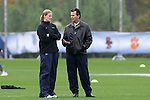 05 November 2008: North Carolina head coach Anson Dorrance (right) and assistant coach Cindy Parlow (left) talk during pregame warmups. The University of North Carolina defeated the University of Miami 1-0 at Koka Booth Stadium at WakeMed Soccer Park in Cary, NC in a women's ACC tournament quarterfinal game.