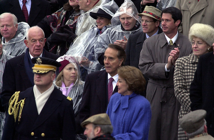 28bush012001 -- Members of Congress wait in the poring rain for George W. Bush to be sworn in as the 43rd President of the United States.