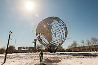 "The Unisphere and the New York State Pavilion, left, from the 1964-65 World's Fair in Flushing Meadows Park in Queens in New York on Saturday, February 22, 2014.  The landmarked ""ruin"" designed by the noted architect Philip Johnson has fallen into disrepair over the years. The NYC Dept. of Parks and Recreation estimated that it would costs $72 million to fully restore it, preserving it as a ""ruin"" but stabilized would run $50 million and demolition would only cost $14 million. A number of elected officials and preservationists are working toward preservation of the historic structure. This year is the 50th anniversary of the World's Fair. (© Richard B. Levine)"