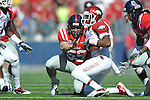 Ole Miss' Will Denny (59) vs. Arkansas wide receiver Joe Adams (3) at Vaught-Hemingway Stadium in Oxford, Miss. on Saturday, October 22, 2011. .