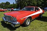 Old Westbury, New York, United States. 7th June 2015. A red and white 1976 Ford Gran Torino, owned by Peter Caiola, is featured at the 50th Annual Spring Meet Car Show sponsored by Greater New York Region Antique Automobile Club of America. The car is like the Starksy and Hutch TV show car. Over 1,000 antique, classic, and custom cars participated at the popular Long Island vintage car show held at historic Old Westbury Gardens.