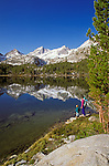 Mother and kids on the shore of Long Lake, John Muir Wilderness, Sierra Nevada Mountains, California USA