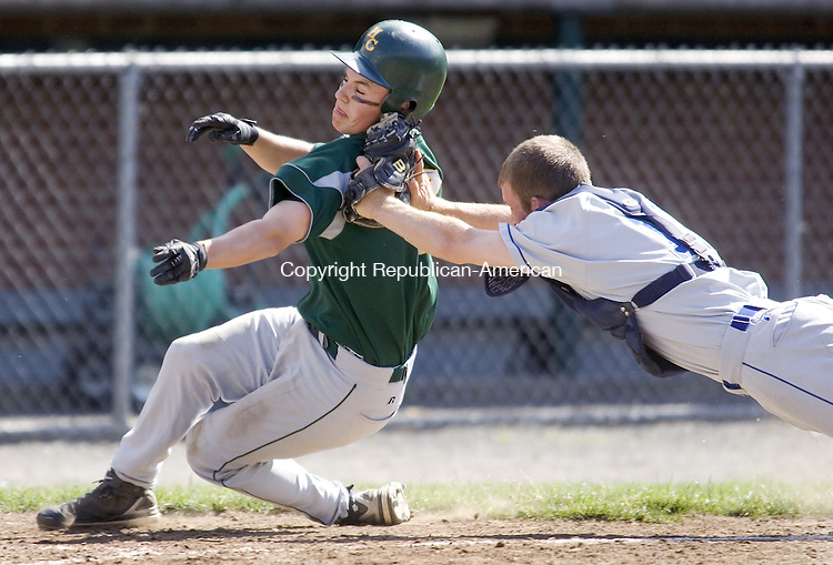 BRISTOL, CT. 01 June 2008-060108SV10--#7 Nick Chiovitti of Holy Cross gets  tagged at the plate by #11 Bobby Kilpatrick of East Catholic during CIAC Class M quarterfinal action at Muzzy Field in Bristol Sunday. Holy Cross won 3-1.<br /> Steven Valenti Republican-American