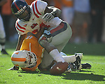 Tennessee defensive back Janzen Jackson (15)  fumbles as he is hit by Ole Miss running back Brandon Bolden (34) on a punt in a college football game at Neyland Stadium in Knoxville, Tenn. on Saturday, November 13, 2010. Tennessee recovered. Tennessee won 52-14.