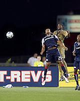 New England Revolution defender Darrius Barnes (25) and Philadelphia Union forward Danny Mwanga (10) battle for head ball. The Philadelphia Union defeated New England Revolution, 2-1, at Gillette Stadium on August 28, 2010.