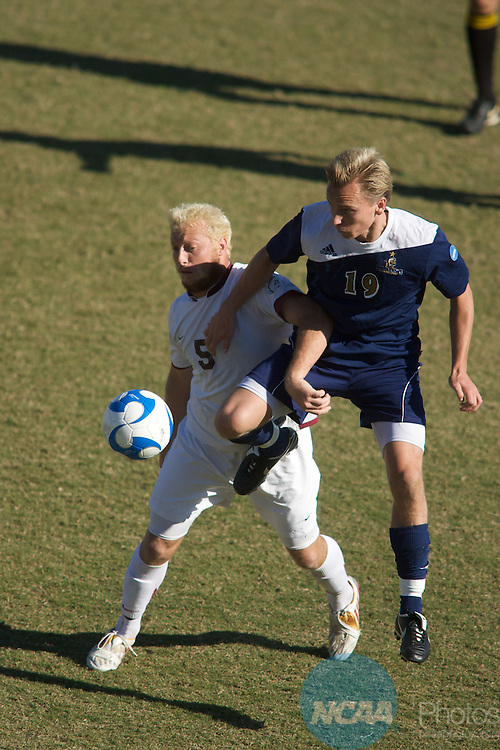 07 DEC 2008: Kris Clark (5) of CSU-Dominguez Hills and Carl Rydin (19) of Dowling battle for the ball during the Division II Men's Soccer Championship held at Pepin/Rood Stadium on the University of Tampa campus in Tampa, FL. CSU- Dominguez Hills defeated Dowling 3-0 for the national title.  Chris Livingston/NCAA Photos