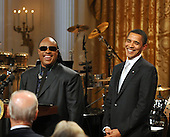 Washington, D.C. - February 25, 2009 -- Stevie Wonder makes remarks as United States President Barack Obama looks on during the taping of &quot;Stevie Wonder In Performance at the White House: The Library of Congress Gershwin Prize&quot; to showcase an evening of celebration at the White House in honor of musician Stevie Wonder's receipt of the Library of Congress Gershwin Prize for Popular Song in the East Room of the White House in Washington, D.C. on Wednesday, February 25, 2009..Credit: Ron Sachs / Pool via CNP