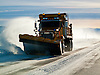 A snow plow clears the road from a winter storm in Teton National Park near Jackson, Wyoming.