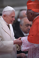 Monzabic Cardinal Julio Duarte Langa.Pope Benedict XVI,during a consistory for the creation of new Cardinals at St. Peter's Basilica in Vatican.February 14, 2015