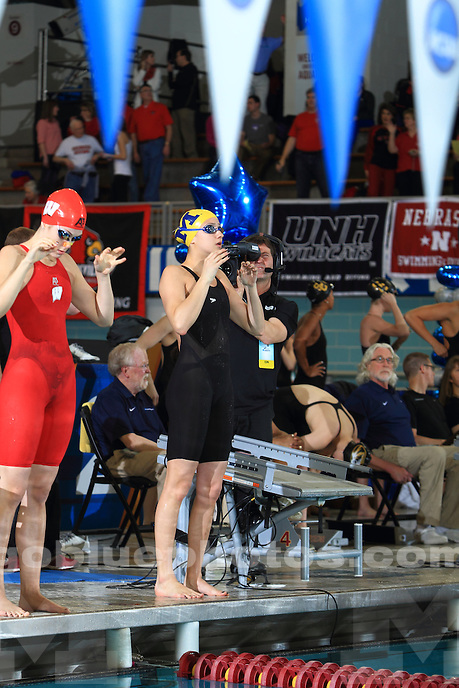 The University of Michigan women's swimming and diving team compete on the second day of the 2014 NCAA Women's Swimming and Diving Championships in Minneapolis, Minn., on March 21, 2014.