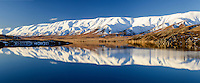 Snowy Hawkdun Ranges reflected in Falls Dam, near St Bathans, Central Otago, New Zealand - stock photo, canvas, fine art print